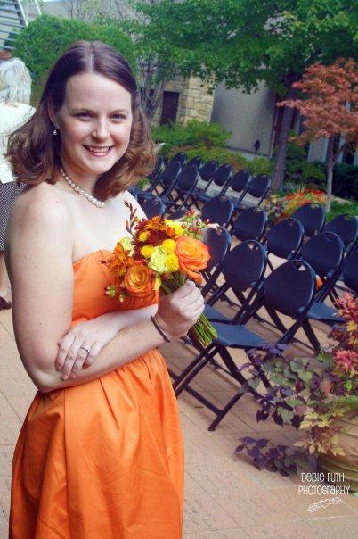 orange bridesmaid with bouquet