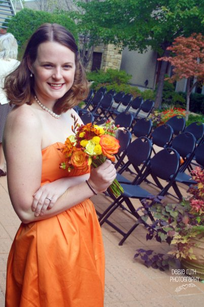 orange bridesmaid with bouquet