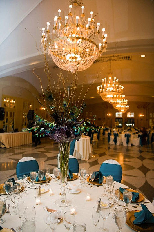 The shorter gold and white centerpieces included white hydrangea