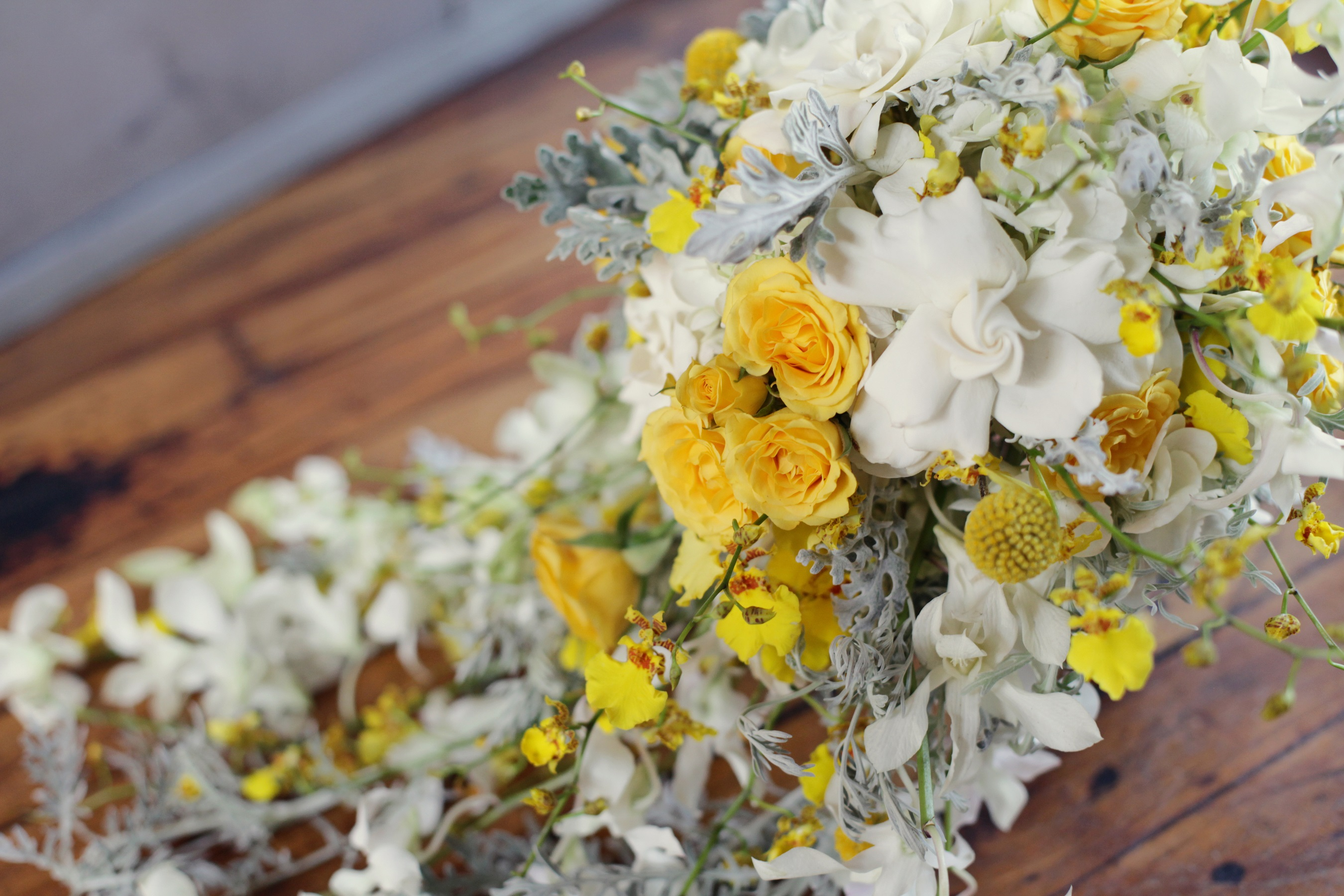 Yellow and grey cascading bouquet
