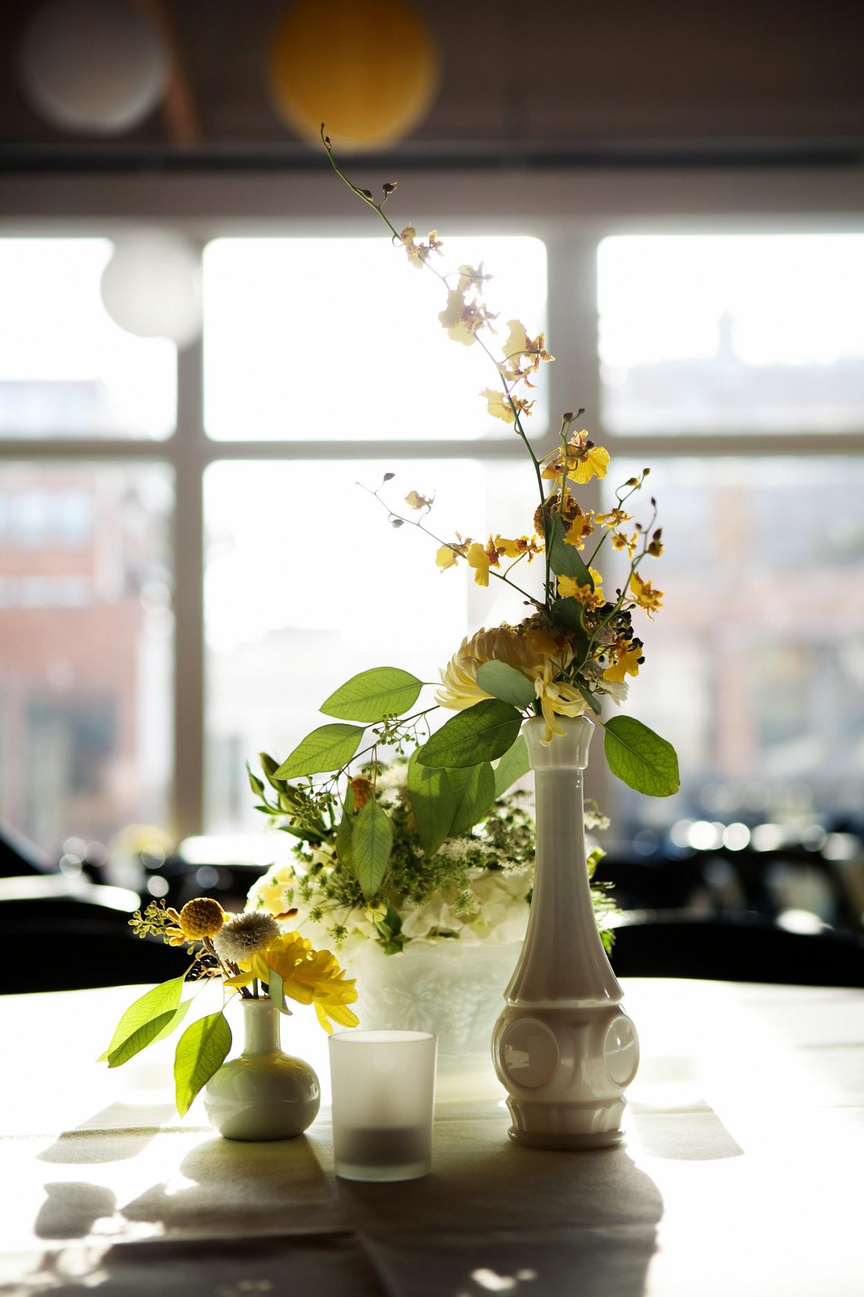 yellow bud vase centerpiece