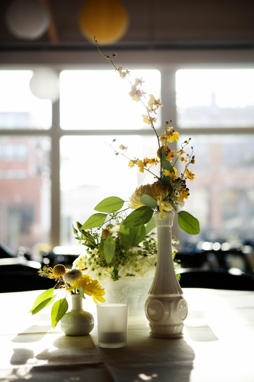 yellow bud vase centerpiece
