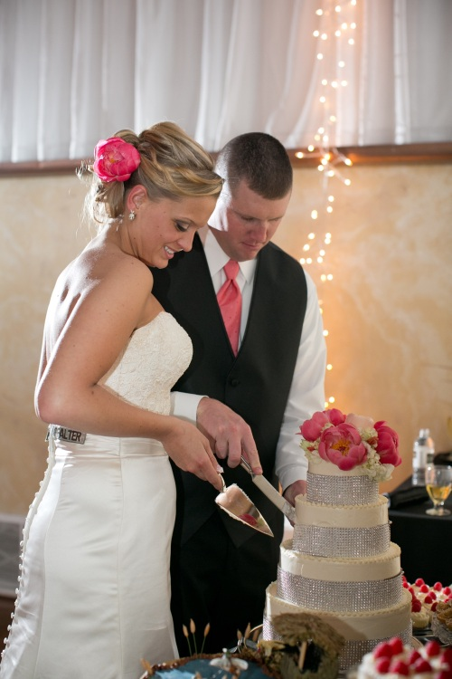 cutting the bling bridal cake